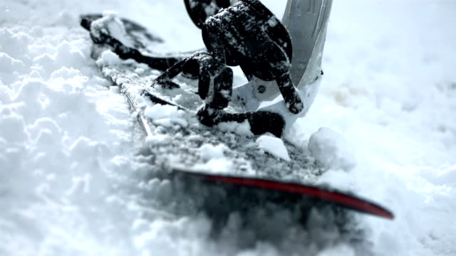 hd super slow-mo: snowboard laying in the snow - winter sport stock videos and b-roll footage