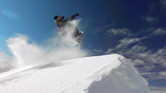 super slow-mo: snowboarding backflip - stunt stock videos & royalty-free footage