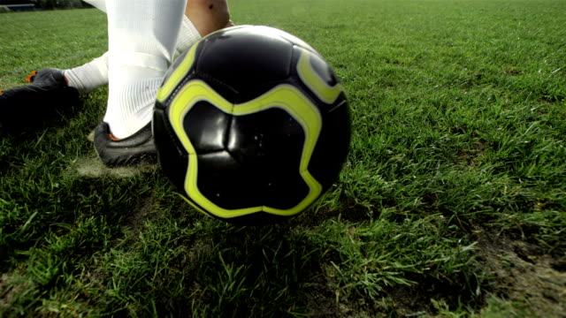 hd super slow-mo: soccer player performing a sliding tackle - kicking stock videos & royalty-free footage