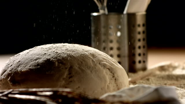 hd super slow-mo: sprinkling flour on bread - peasant bread stock videos and b-roll footage