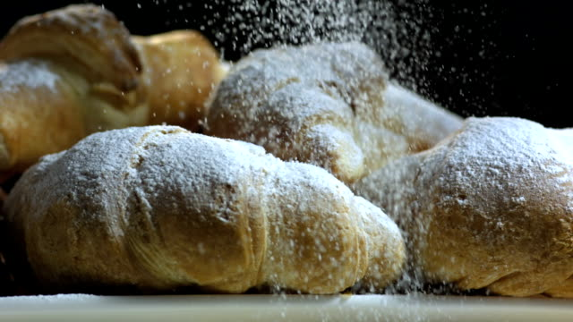 hd super slow-mo: sprinkling powdered sugar over croissants - cream cake stock videos & royalty-free footage