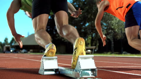 hd super slow-mo: sprinters runs off - track and field stock videos & royalty-free footage