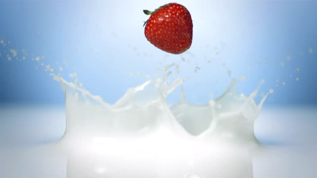 HD Super Slow-Mo: Strawberries Splashing Into Milk
