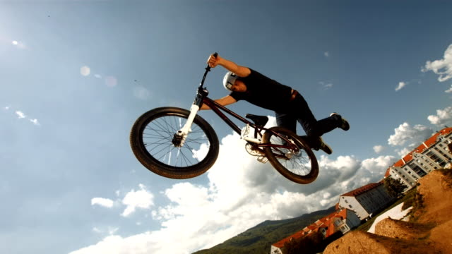 hd super slow-mo: superman bmx dirt trick - bmx cycling stock videos and b-roll footage