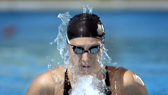 hd super slow-mo: swimmer performing the breaststroke - swimming cap stock videos and b-roll footage