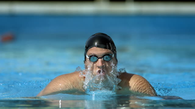 HD Super Slow-Mo: Swimmer Performing The Breaststroke