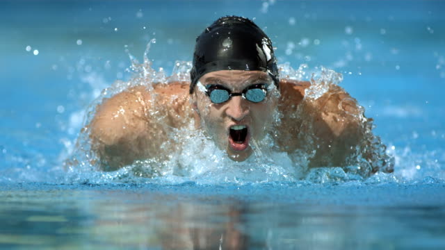hd super slow-mo: swimmer training the butterfly stroke - sport stock videos & royalty-free footage