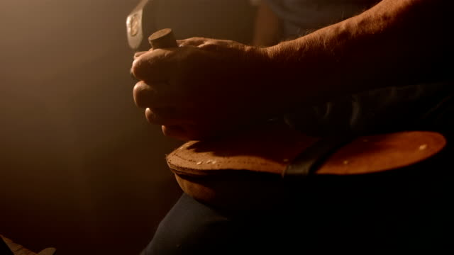 hd super slow-mo: traditional shoemaker repairing the outsole - craftsman stock videos and b-roll footage