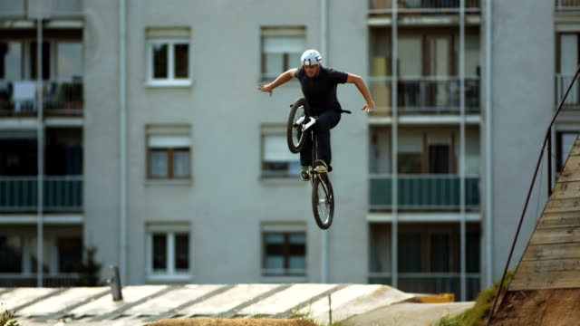 hd super slow-mo: tuck no hander mbx trick - bmx cycling stock videos and b-roll footage