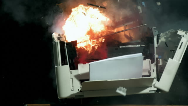 stockvideo's en b-roll-footage met hd super slow-mo: vintage computer printer explosion - studio shot