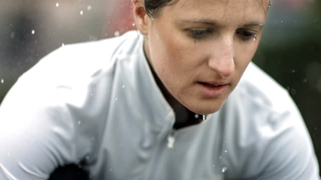 hd super slow-mo: vital woman in the rain - sports training stock videos & royalty-free footage