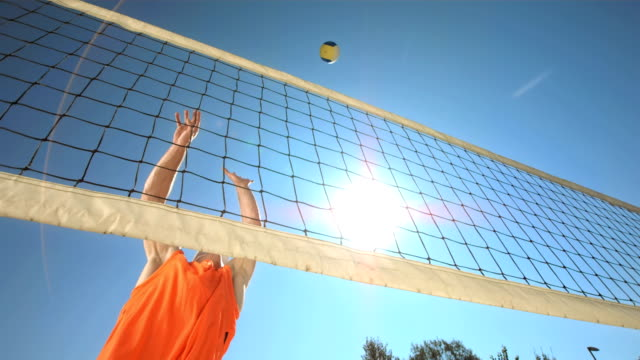 hd super slow-mo: volleyball player making a jump serve - volleyball sport stock videos and b-roll footage