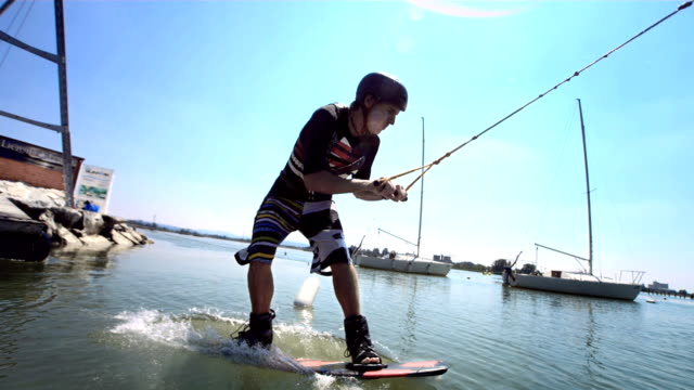 hd super slow-mo: wakeboard start - wakeboarding stock videos and b-roll footage