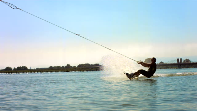 hd super slow-mo: wakeboarder in action - wakeboarding stock videos and b-roll footage