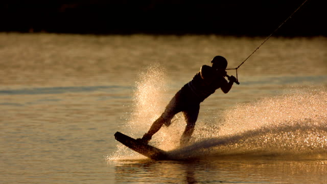 hd super slow-mo: wakeboarding at sunset - waterskiing stock videos & royalty-free footage