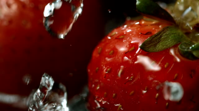 hd super slow-mo: water drops falling on a strawberry - washing stock videos & royalty-free footage