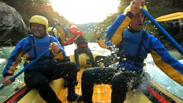 hd super slow-mo: white water rafting - inflatable raft stock videos and b-roll footage