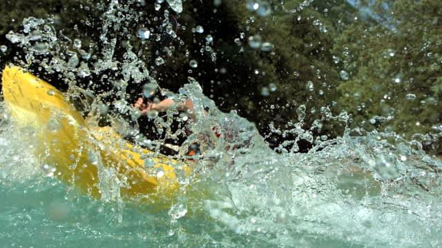 hd super slow-mo: whitewater kayaker splashing water - inflatable raft stock videos and b-roll footage