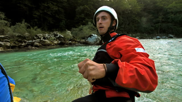 hd super slow-mo: whitewater rafting guide - rafting stock videos and b-roll footage