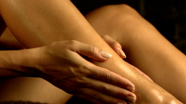 hd super slow-mo: woman applying massage oil - femininity stock videos and b-roll footage