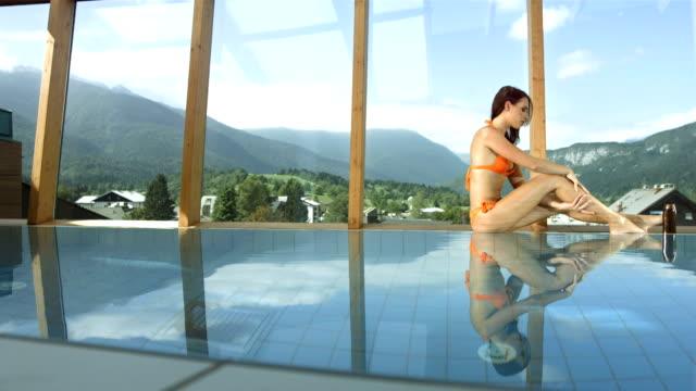 hd super slow-mo: woman massaging her legs - bikini stock videos and b-roll footage