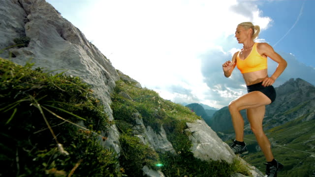 hd super slow-mo: woman running uphill - competitive sport stock videos & royalty-free footage