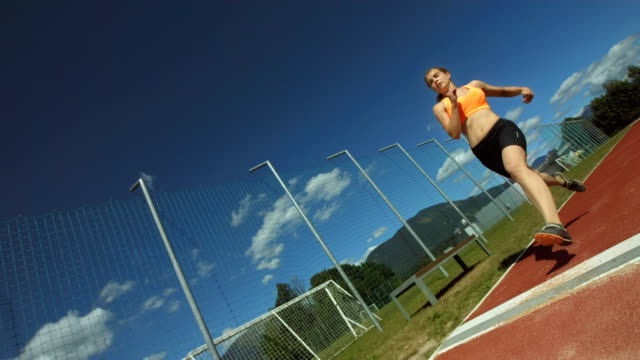 hd super slow-mo: woman taking off for a long jump - long jump stock videos & royalty-free footage