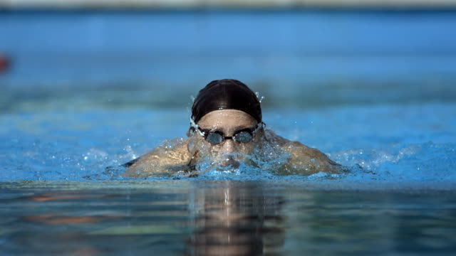 HD Super Slow-Mo: Woman Training The Butterfly Stroke