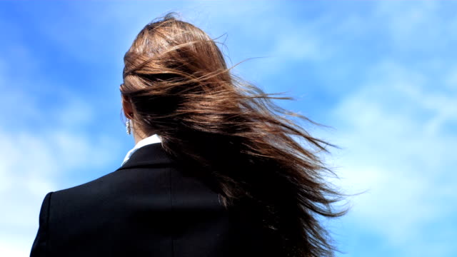 hd super slow-mo: woman's hair blowing in the wind - brown hair stock videos & royalty-free footage