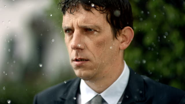 hd super slow-mo: worried businessman in the rain - displeased stock videos and b-roll footage