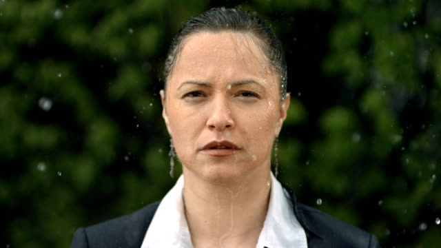HD Super Slow-Mo: Worried Businesswoman In The Rain