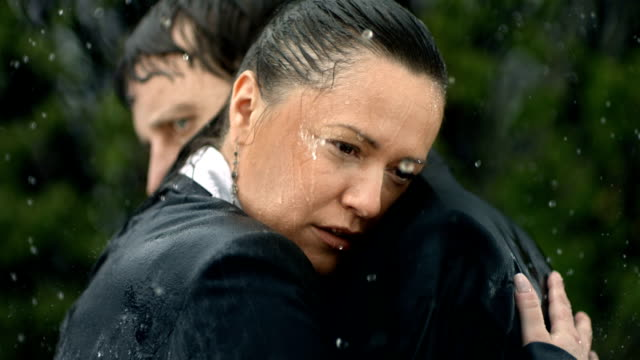 hd super slow-mo: worried couple in the rain - grief stock videos & royalty-free footage