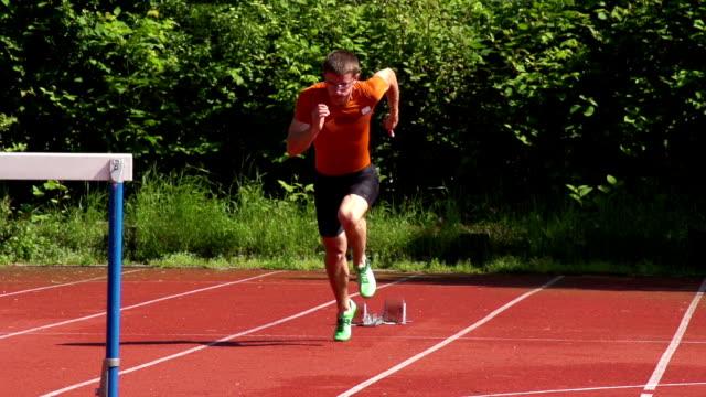 hd super slow-mo: young man at 110m hurdle run - hurdle stock videos & royalty-free footage