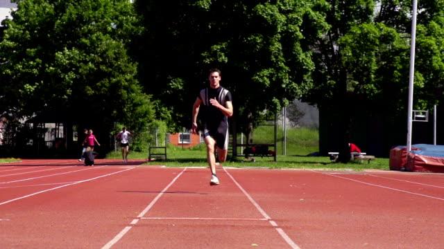 hd super slow-mo: young man at long jump - long jump stock videos & royalty-free footage