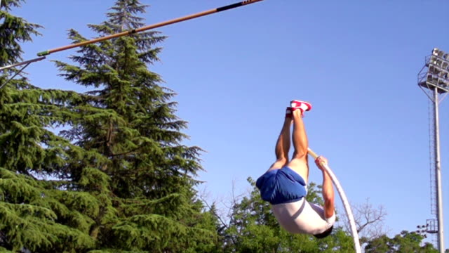 hd super slow-mo: young man at pole vaulting - pole stock videos & royalty-free footage