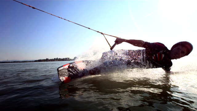 hd super slow-mo: young man enjoys cable wakeboarding - exhilaration stock videos & royalty-free footage