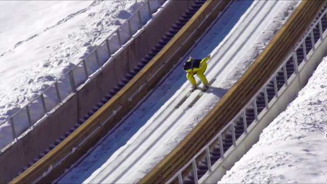 hd super slow-mo: young man performing ski jump - winter sport stock videos & royalty-free footage