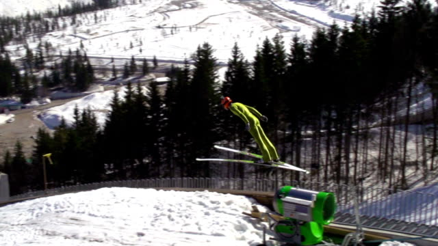 hd super slow-mo: young man performing ski jump - jumper stock videos and b-roll footage