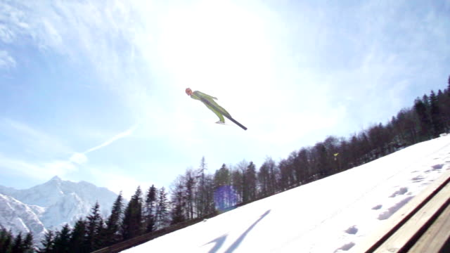 HD Super Slow-Mo: Young Man Performing Ski Jump
