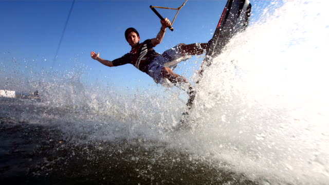 hd super slow-mo: young man posing while wakeboarding - wakeboarding stock videos and b-roll footage