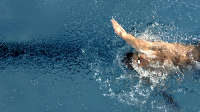 hd super slow-mo: young man swimming backstroke - backstroke stock videos & royalty-free footage