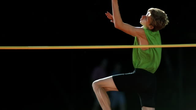 hd super slow-mo: young man training a high jump - horizontal bar stock videos and b-roll footage
