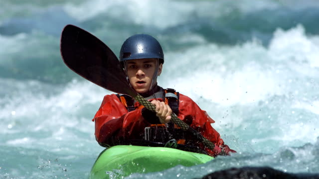 hd super slow-mo: young whitewater kayaker - rapid stock videos & royalty-free footage