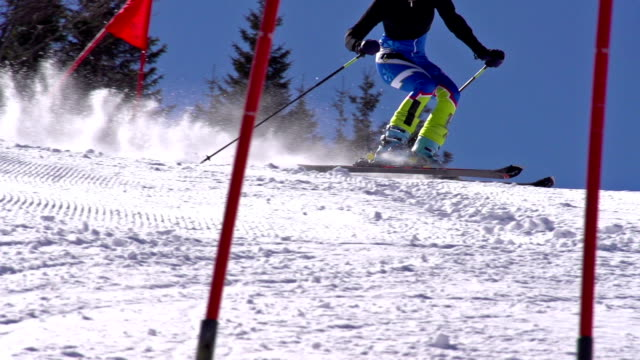 hd super slow-mo: young woman practicing giant slalom - slalom skiing stock videos & royalty-free footage