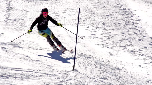 hd super slow-mo: young woman practicing slalom - winter sport stock videos and b-roll footage