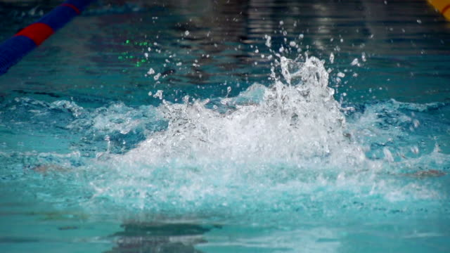 HD Super Slow-Mo: Young Woman Swimming Butterfly