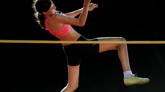 HD Super Slow-Mo: Young Woman Training A High Jump