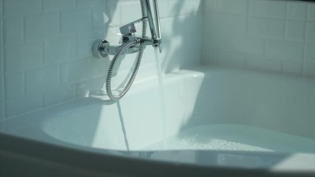 super slow-motion : running water splashing over bath tub - bubble bath stock videos and b-roll footage