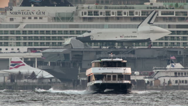 super telephoto shot of a ny waterways ferry, the shuttle enterprise, the concorde, and a cruiseliner on the hudson river. - british aerospace concorde stock videos and b-roll footage