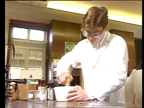 superconductors could lead to scientific breakthroughs england cheshire helsby high school int 'a' level student's hands pour mixture into pestle and... - skibrille stock-videos und b-roll-filmmaterial